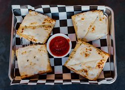 Cheesy garlic bread is a perfect appetizer.