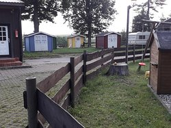 Sleeping cabins, kids play area and entrance to shower / toilet block.