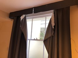 Curtains hanging off ....... this was rectified