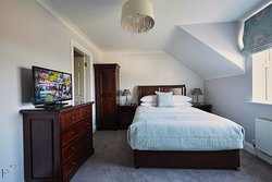 With a view of the Atlantic Ocean, Doolin Village and the 500 yr old Doonmacfelim Castle our Atlantic View Room is spacious room. The room has a Luxurious King bed, a sofa and an en-suite bathroom.