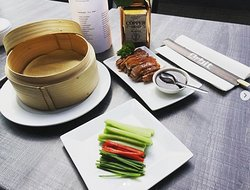 Peking Duck : Authentic roasted duck served with pancakes