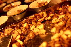 Our golden roasted Patatas Bravas