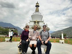 Kim and Kathleen from Australia in front of the Memorial Chorten in Thimphu with guide Phub