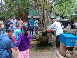 Cambodia people respect linga at Phnom Kulen waterfall mountain