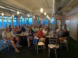 Upstairs enjoying friends, family, food, beverage, and of course Noto's incredible view. You will not find a better view of Lake Michigan from Grand Haven.