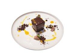 """Cubical"" dark chocolate mousse, mango heart, sweet spicy milk chocolate gelée, yogurt & passion fruit souce"