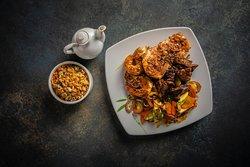 Teppanyaki: Mikado; American strip loin with mushrooms, lobster, fresh coriander, tiger prawns, sweet chili, seabass, lemon, garlic, green mussels and green pepper.