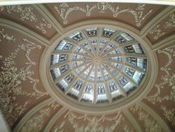 The stained glass looking up in the dome