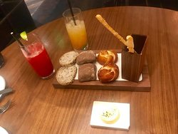 Refreshing non alcoholic cocktails and an assortment of fresh breads with herbed butter