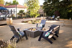 Enjoy a glass of wine at our new fire tables