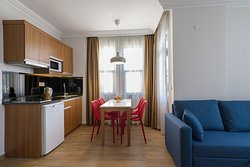 Living Room with Kitchenette and Dining Table