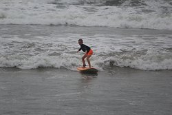 My son surfing away after 1 lesson