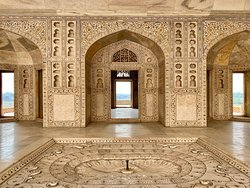 Interior building with detailed decorations at Agra Fort.