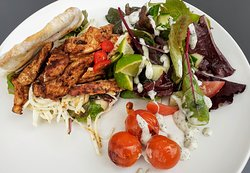 Garlic and herb chicken with celeriac remoulade, oven-blushed cherry tomatoes and homemade rosemary flatbread £6