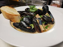This Week's Fresh Catch is P.E.I. Mussels with Guinness, house white sauce, bacon, red pepper flake, garlic, and  sun dried tomatoes, served with a baguette to soak up all that delicious juice!