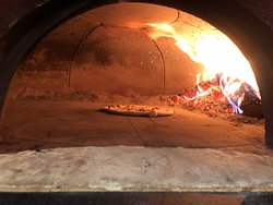 Wood fired pizzas made to order.