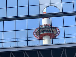 Reflection of Kyoto Tower on Kyoto Train Station Building--Kyoto, Japan