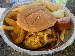 Crab cake sandwich with fries and 2 onion rings