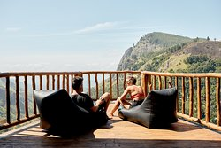 Wooden balcony with bean bags....