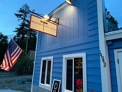 Woods Bay Wine in Big Fork, MT serves delicious meals, but the sign doesn't say that.