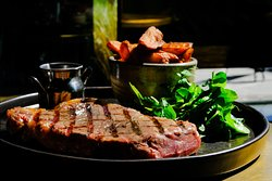 Rib-eye steak with handcut chips.