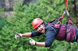 Face-first ziplining at the end of the day on your zipline extreme with rappelling experience with ONE AXE Pursuits in Elora, Ontario.