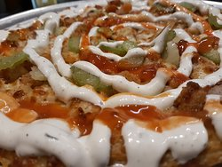 Hotwing Pizza: loaded with crispy chicken, chopped celery then drizzled with Frank's RedHot and our Famous Homemade Ranch.