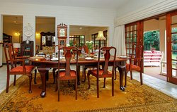 The Dining Room at the Manor - opening out on to the patio and swimming pool area.