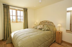 Downstairs double bedroom in Threshing Hall Barn.