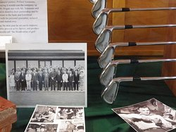 Photographs and golf clubs inside the Ben Hogan Museum of Dublin, Texas.