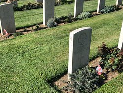 Small Canadian flag to be found in front of some tombs