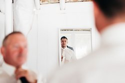 There is a separate space for the groom in our grooms suite!  Photo by: Karina Jensen Photography