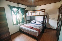 We have 2 Double Bed Rooms with a King Size and an extra Bunk Bed. Suitable for 2 to 3 persons. All rooms are air-conditioned and have a private bathroom with a hot shower.
