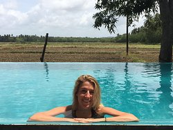 Infinity pool overlooking the rice fields