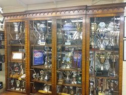 One of two Tropghy cupboards, with trophies won by Ali Machinchy Junior (Buisness founding member) and other rc memorabilia.