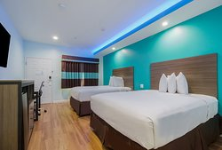 Double Queen bed with dimmer light & blue LED on top of ceiling