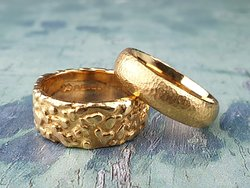 Two handmade rings in 22ct gold.