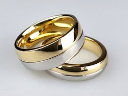 A pair of bespoke wedding rings in 18ct gold and platinum.