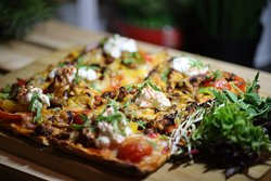 Thai chicken flat bread with sour cream and mixed cheese.