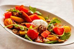Local Heirloom Tomato And Burrata  Heirloom Tomatoes, Burrata, Watermelon, Arugula, Candied Walnuts