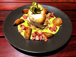 Pan Seared Sword Fish served on a bed of braised cabbage served with bacon potatoes, pickled courgette in a dill cream sauce