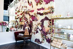 Snap a picture of your dessert in front of this gorgeous flower wall.