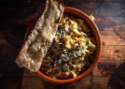 Lasagna edges, mixed mushrooms, hard herbs, ans brown butter parmigiano with cheese toast.