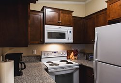 • A full kitchen with appliances and icemaker • Fully equipped kitchen with utensils and cookware