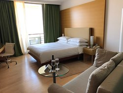 View into room, king bed, chaise lounge sofa