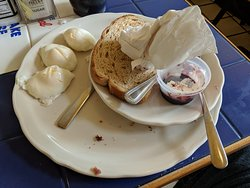 Solidly cooked poached eggs.