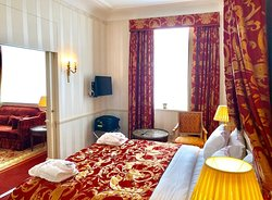 Isadora Duncan Signature Suite - Bedroom with King bed, and sliding doors to livingroom.