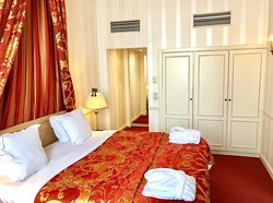 Isadora Duncan Signature Suite - Bedroom with King bed, closet, and access to bathroom.