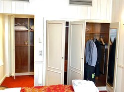 Isadora Duncan Signature Suite - Bedroom with King bed, closets, and access to bathroom.