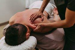 Client Experiencing Deep Tissue Massage